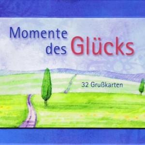 Kartenaufsteller - Momente des Glücks - 32 Postkarten, mit Passepartout